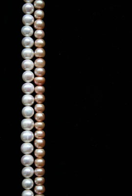 white-pearls-and-pink-pearls-over-black